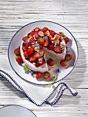 Strawberry cheesecake, partly sliced