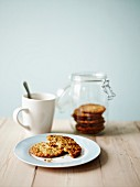 Anzac biscuits (Australia) in a jar and on a plate