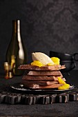 Chocolate waffles with chestnut mousse and orange sauce