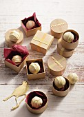 Chocolate pralines in little wooden boxes