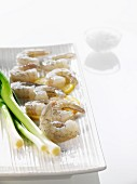 Raw prawns on sliced lemon