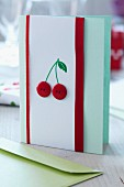 Hand-crafted card decorated with cherries made from red buttons