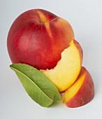 A nectarine and wedges of nectarine