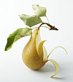 A pear, partly peeled