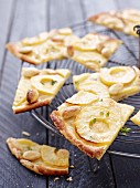 Tarte flambée with apples, almonds and thyme