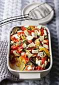 Millet bake with tomatoes, courgette, aubergine, peppers and goat's cheese