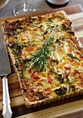 Wholemeal quiche with spinach, onions, peppers and brie cheese
