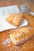 Apple pastries dusted with icing sugar