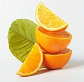Orange halves and orange flowers