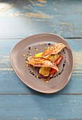 Red mullet fillet with fried vegetables