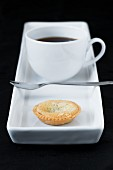 cup of coffe with small almond tart