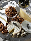 A cheese platter with Brie and Camembert, caramelised nuts and figs in syrup