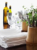 Napkins, cutlery and wine glasses on a table