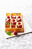 Waffle with lemon cream and fresh raspberries