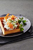 Savoury waffle with salmon, prawns and cucumber