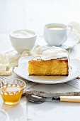 A slice of polenta cake with syrup and cream