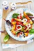 A summer peach & tomato salad with nasturtiums and young chard leaves