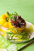 A pepper stuffed with colourful quinoa, sundried tomatoes and olives