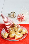 Christmas decorations, a paper cone, heart-shaped biscuits and a paper star