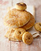 Sesame flatbreads, sesame bagels and a poppy seed bagel
