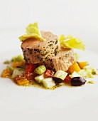 Veal fillet with herbs on mixed vegetables