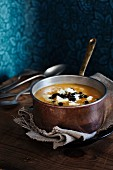 Pumpkin and parsnip soup with sheep's cheese and roasted pumpkin seeds