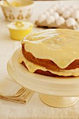 Boston Cream Pie, sponge cake with a vanilla cream filling and a white chocolate glaze