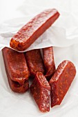 Landjäger (smoked cured speciality sausage made from beef and pork), whole and cut into pieces