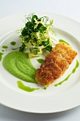 Fried sea bass fillet with pea purée and a side salad