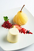 Vanilla posset with berries and a poached pear