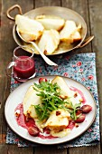 Pears topped with Taleggio and baked, served with a grape sauce and rocket