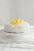 A lemon layer cake on a cake stand