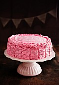Raspberry layer cake on a cake stand