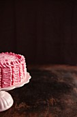 Raspberry layer cake on a cake stand (section)