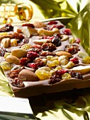A slab of chocolate with dried fruits and nuts