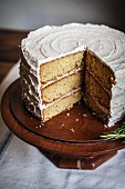 Rosemary Corn Cake with Brown Butter and Honey Buttercream Frosting on a Wooden Cake Plate