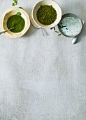 Three different herb-based salad dressings