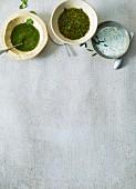 Three different herb-based salad dressings