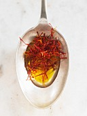 Saffron threads in oil on a spoon