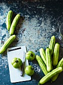 Green tomatoes and peeled cucumbers for pickling