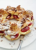 Choux pastry crown with strawberries and macadamia nuts