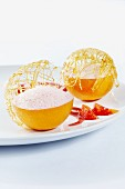 Blood oranges filled with a dessert made of blood orange juice, cream and sugar, topped with a caramel lattice