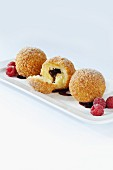 Chocolate dumplings with raspberries and a wild fruit sauce
