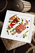 Fried duck breast with cherry sauce and spring vegetables