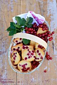Fairy cakes with redcurrants, in a punnet