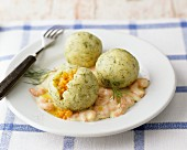Stuffed dill dumplings on prawn sauce