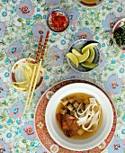 Asian soup with noodles and meat