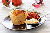 Fish soufflé with tomato and pepper sauce
