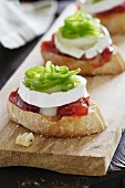 Toast topped with tomato jam, goat's cheese and confit of green peppers
