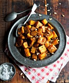 Oven-roasted diced squash with pine nuts